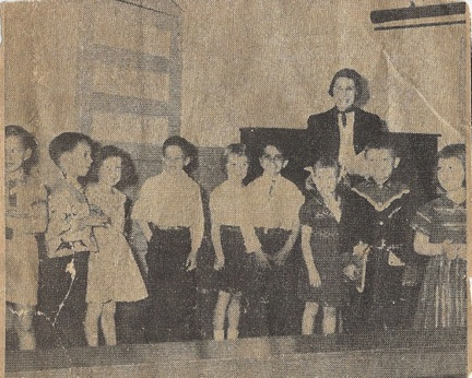 The only picture of my elementary school. From a newspaper clipping. I am the third from left.