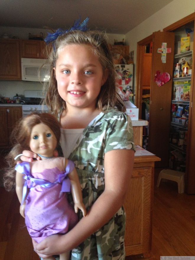 Here's Emilie with a dress she designed for her doll.